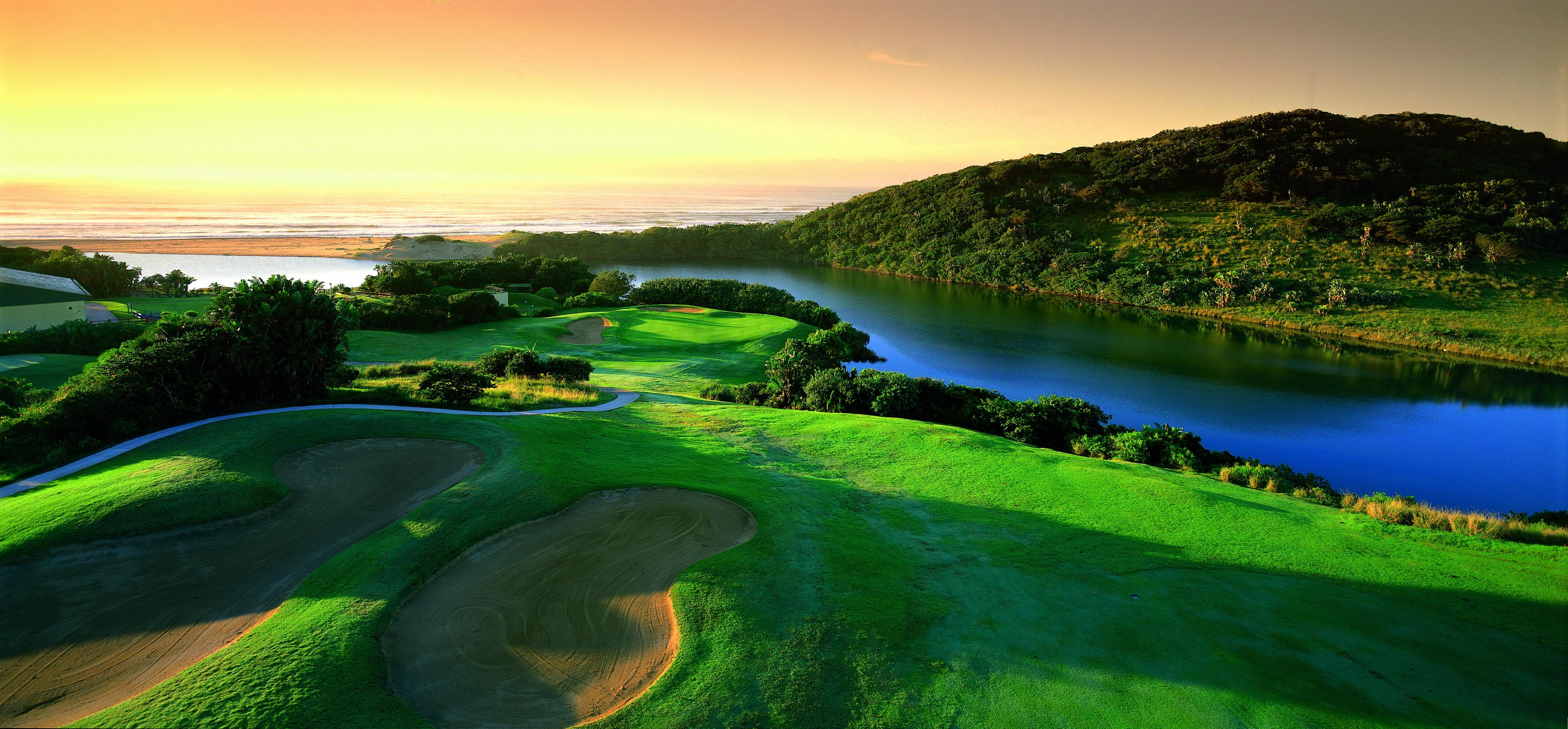 Wild Coast Country Club – 1st hole locally known as Charlies Angels –  Mzamba River in the background golf